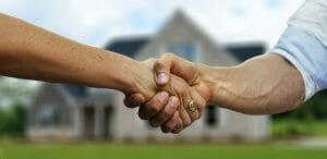 Vancouver moving company estimator shakes hands with client